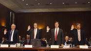 Current and former HSBC Bank executives are sworn in before the Senate Homeland Security and Governmental Affairs Committee in Washington