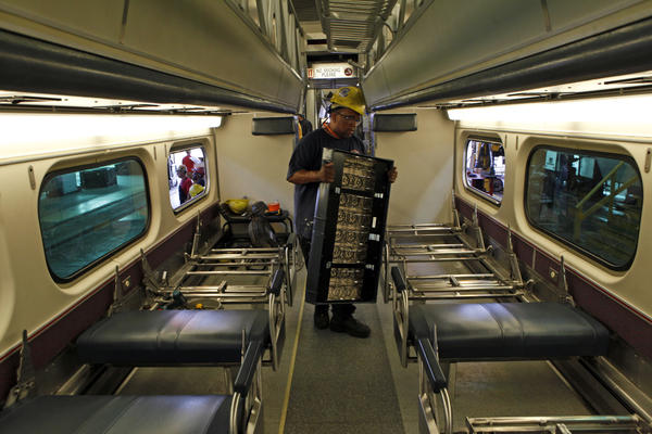 Calvin Jackson installs seat frames and seats in a train car on Tuesday. Metra is refitting 176 cars built between 1995 and 1998.