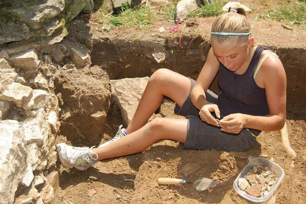 Alia Hughes, 12, examines a possible artifact during an archaeology camp being held in Waynesboro, Pa.