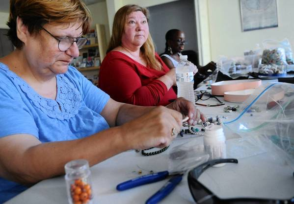 Members of the group (from left) Valerie Cassella of Brodheadsville, Sandy Buchbinder of Bethlehem and Robbie Matthews of Hamburg work on their jewelry. The Cancer Support Community of the Greater Lehigh Valley held a jewelry-making class Tuesday at the Park Plaza Building in Bethlehem.
