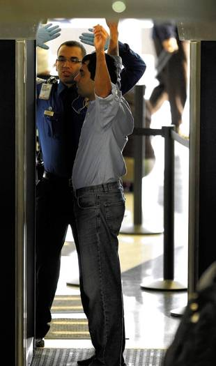 Passengers going through full body scanners at O'Hare International airport between 1-2 p.m. on Monday, November 15, 2010.