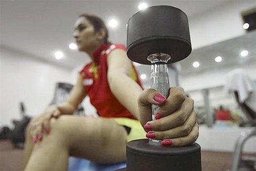 Woman holds dumbbell during workout