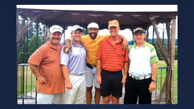 The winning team at the Forbes Trail Golf Outing included, from left, Chris Harbaugh, Nick Sanner, Louis Lipps (celebrity guest), Roger Young and Jim Harbaugh.
