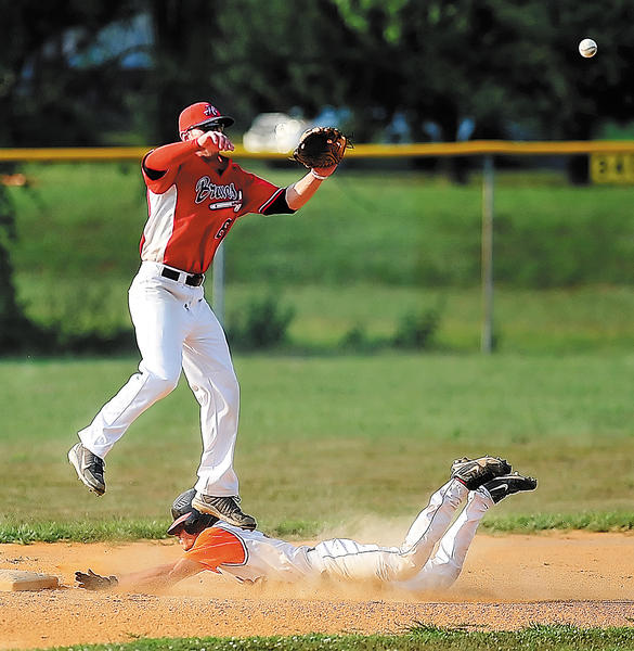 Hagerstown infielder Tim Kellinger jumps to pull down a throw as Brunswick's Bryan Nolan slides safely into second base on Tuesday during the Braves' 8-5 Blue Ridge Adult League win.