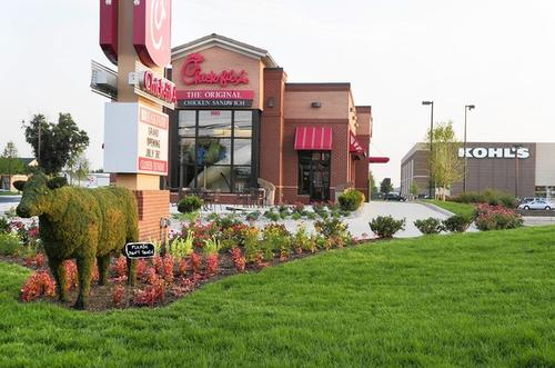 Complete with a topiary cow out front, the new Chick-fil-A in Forest Hill will open on July 26 by giving away a free year's supply of Chick-fil-A to the first 100 adults in line grand opening morning.