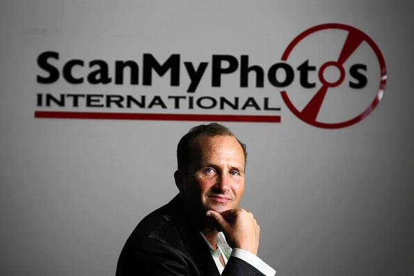 "Mitch Goldstone, president and chief executive of ScanMyPhotos, in his Irvine office. Goldstone was a lead plaintiff in antitrust litigation against Visa, MasterCard and the banks that issue their cards over credit card ""swipe fee."""