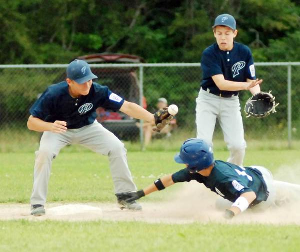 Petoskey shortstop Jordan Swiss (left) tries to control the ball as Sault Ste. Marie's Owen Mills reaches for second base Tuesday during the Little League Junior Division District 13 championship game at Pioneer Park in Pellston. Sault Ste. Marie won, 5-2, to eliminate Petoskey from the tournament.