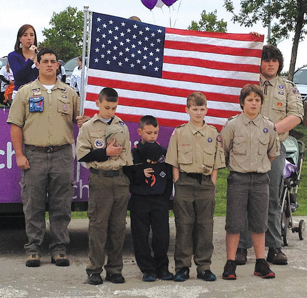 Participating in the flag cermony at the Hagerstown March of Dimes Walkathon were, front row, from left, Camden Casey, Carson Casey, Cooper McChesney and Aaron Little. Back row, holding the flag, at left, is David Paddack. Holding the flag, at right, is Devon Little.