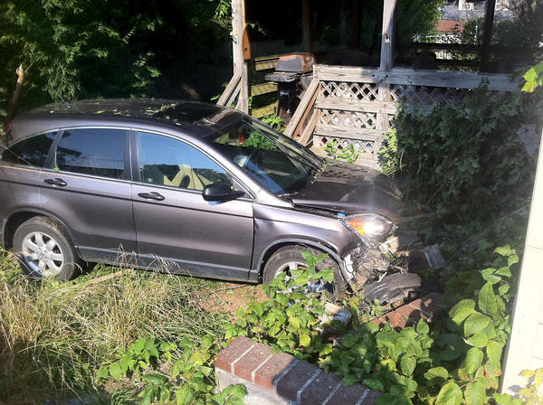 A Honda CR-V came to rest near a house on the 7900 block of Sharpsburg Pike (Md. 65) following a crash Wednesday morning.