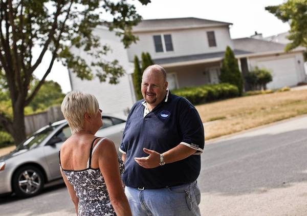 Channahon Mayor Joe Cook talks to resident Bonnie Etienne as he visits a neighborhood affected by proposed Illiana Expressway on Friday, July 13, 2012.