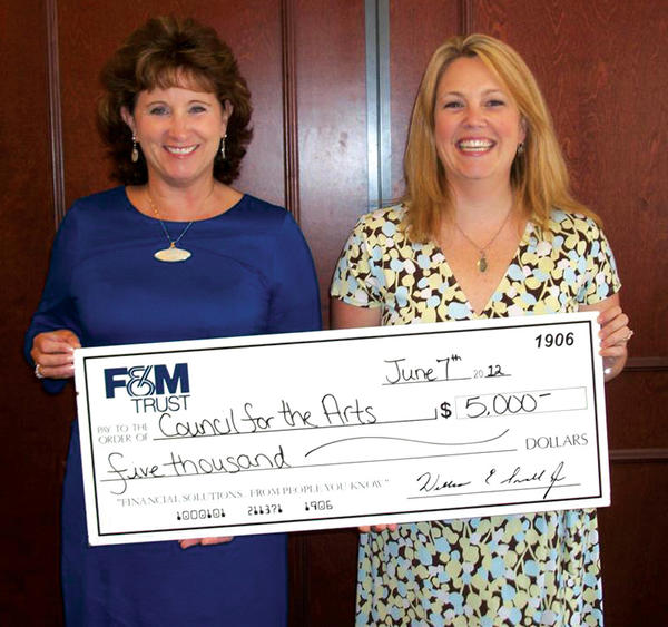 Trish Hanks, senior vice president at F&M Trust, presents a $5,000 check to Stacy Mellot, executive director of the Chambersburg (Pa.) Area Council for the Arts, for sponsorship of the Arts Express program.