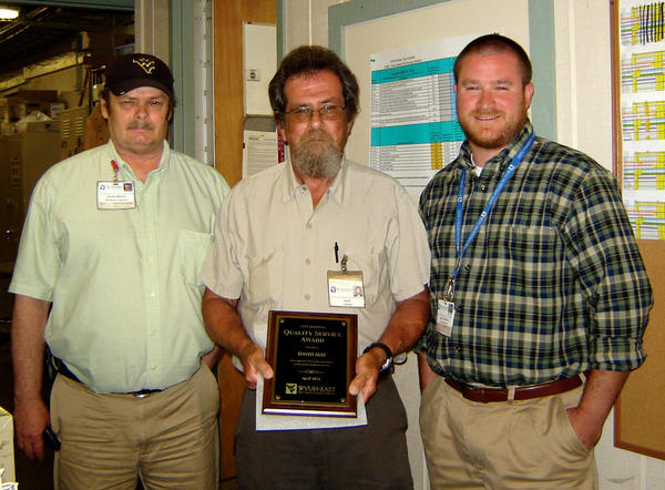 City Hospital's April Quality Service Award winner, David May, center, is pictured with David Bishop, maintenance supervisor, left, and Scott Mathis, facilities manager at the hospital.