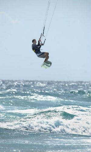 A man kiteboards off Delray Beach. Expect a hot day and maybe some haze on Wednesday.