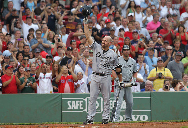 Kevin Youkilis of the Chicago White Sox reacts to the fans before his first at bat against the Boston Red Sox at Fenway Park Tuesday.