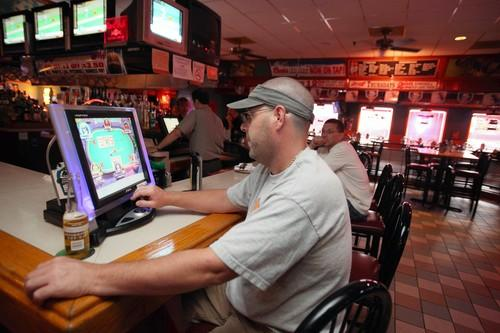 Tony Donnamario of Willow Springs plays a non-gambling video poker game in Countryside.