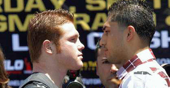 "Saul ""Canelo"" Alvarez, left, and Josesito Lopez face off as they pose for photos during a news conference Tuesday."