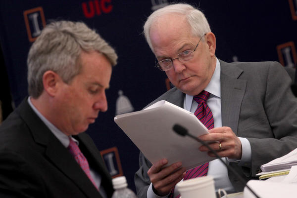 U. of I. board Chairman Christopher Kennedy, left, and President Michael Hogan, right, review proposed tuition increases in January 2012.