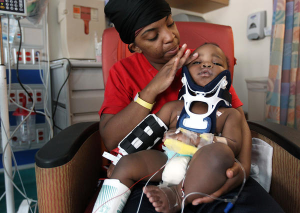 Tiesha Powell holds her 10-month-old son, Kyan, at Comer Children's Hospital in Chicago. Kyan fell from a third story window.
