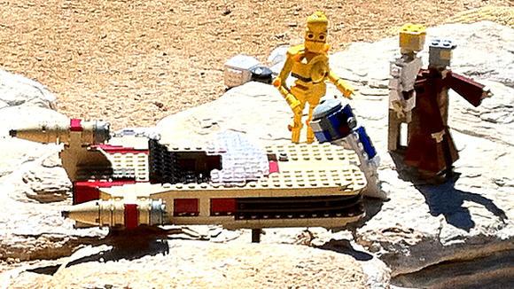 C3PO, R2D2, Luke Skywalker and Obi-Wan Kenobi with a landspeeder in Star Wars Miniland at Legoland California.