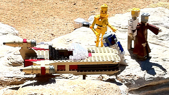 C3PO, R2D2, Luke Skywalker and Obi-Wan Kenobi with a landspeeder in Star Wars Miniland at Legoland California.