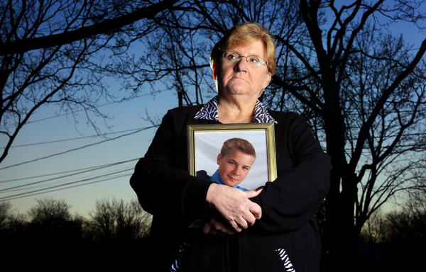 Nanci Koschman, seen in January with a picture of son David, wants a special prosecutor to probe the handling of the investigation of his death. A nephew of then-Mayor Richard Daley was involved in a 2004 fight that killed her son.