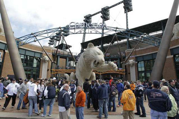 Fans mill about outside Comerica Park before a game in April.