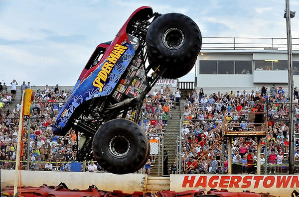 File photo Spiderman, driven by Whit Tarlton of Wadesboro, N.C., gets vertical at the 2011 Monster Jam. The 2012 Monster Jam takes place Friday, July 20, through Sunday, July 22, at Hagerstown Speedway. Among featured trucks will be Grave Digger and Maximum Destruction.