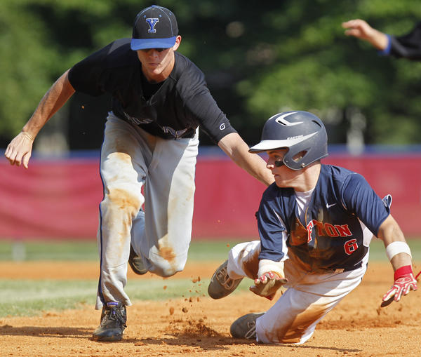 York's Trevor Kelly tags out Grafton's Dylan Bartells between first and second base during the third inning of Thursday's game.