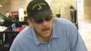 Police in Lawrence hope surveillance pictures lead them to a bank robber.