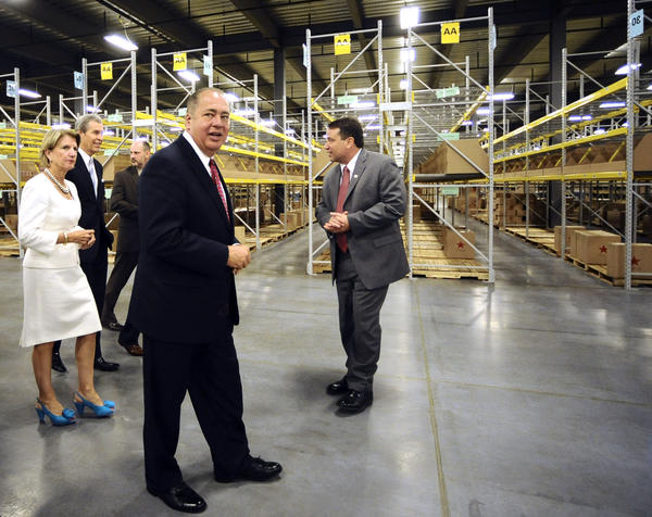 Chuck Basa, right, of Macy's Online Fulfillment Center gives Gov. Earl Ray Tomblin, middle, and Rep. Shelley Moore Capito along with Chairman, President and CEO of Macy's, Inc. Terry J. Lundgren and Scott Prieto a tour through Macy's new facility after a dedication and ribbon-cutting ceremony.