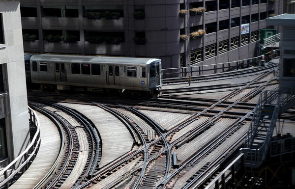 A CTA trains passes through the Tower 18 junction near the Clark/Lake station in Chicago.