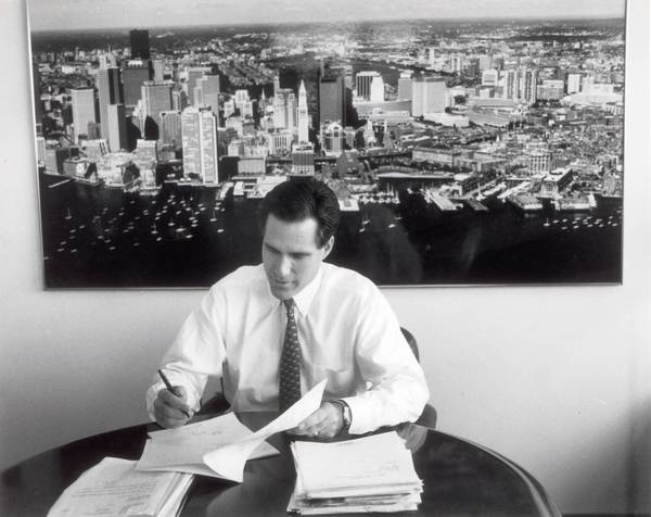 Mitt Romney, seen at Bain Capital in 1993, says he gave up decision-making responsibility at the company in 1999 to head the Salt Lake City Olympic Games.