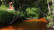 Photo Gallery: Chester Creek Waters Flow Red in Anchorage