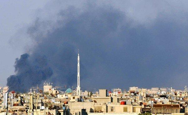An amateur photo shows smoke rising over Damascus after Syrian rebels bombed the national security headquarters, killing the defense minister and two other high-ranking officials.