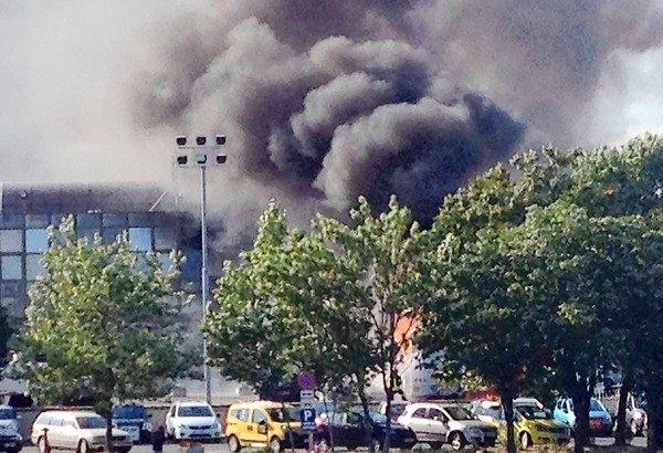Smoke can be seen over the airport in Burgas, Bulgaria, where a tour bus carrying Israeli vacationers exploded, killing at least seven people.