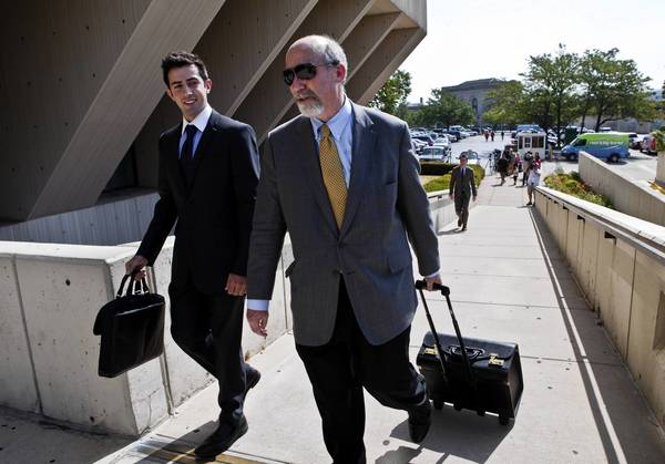 Joel Brodsky, right, an attorney for Drew Peterson, arrives at the Will County Courthouse for a final pretrial hearing Wednesday. Jury selection begins Monday.