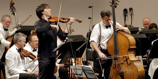 Joshua Bell (left) joins classical/bluegrass bassist Edgar Meyer in Meyer's Double Concerto for violin and bass with French music director, Ludovic Morlot conducting.