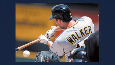 Pittsburgh Pirates' Neil Walker hits a ground ball against the Colorado Rockies in the first inning of a baseball game in Denver on Wednesday.