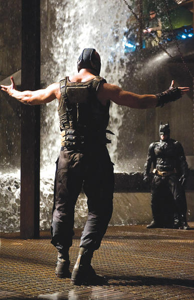 "Tom Hardy stars as Bane in ""The Dark Knight Rises."" Also pictured is Christian Bale as Batman. Warner Bros./MCT Photo"
