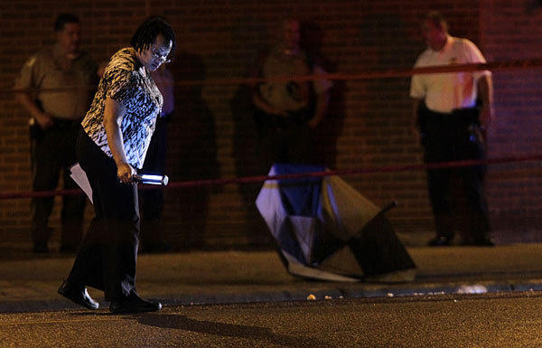 Members of the Chicago Police Department investigate the scene where a Cook County corrections officer was hit by a car late Wednesday.