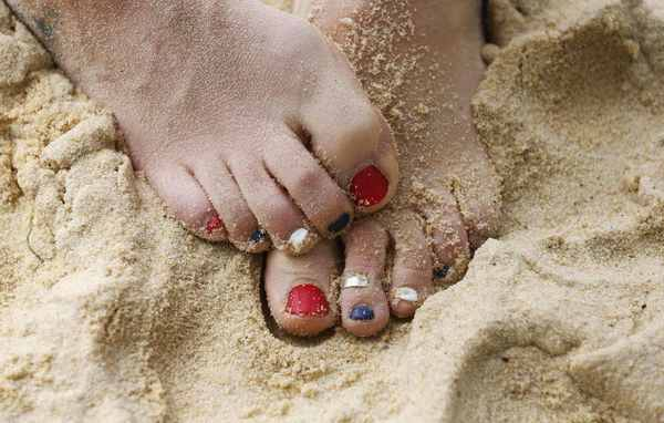 Great Britain's beach volleyball player Shauna Mullin's red, blue and white painted toenails are seen during a training session at the London 2012 Olympics beach volleyball venue in central London.