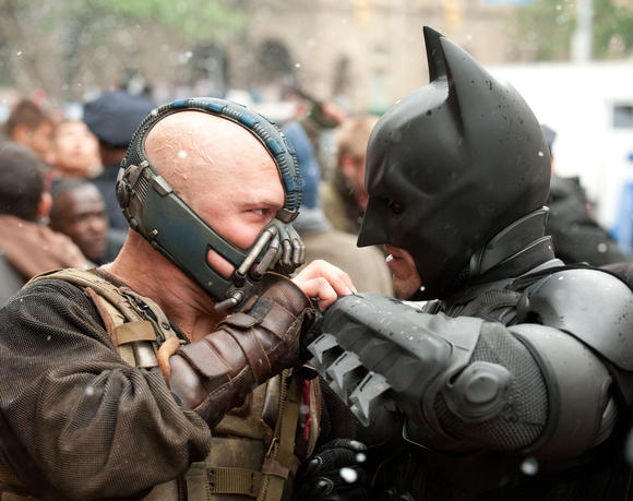 "Tom Hardy as Bane and Christian Bale as Batman face off in ""The Dark Knight Rises."" (Ron Phillips/Warner Bros./MCT)"
