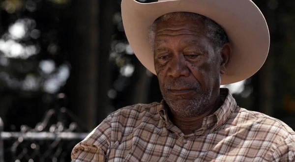 "<b>PG; 1:49 running time</b><Br><br> An aging writer of western novels (Morgan Freeman), recently widowed, plans to while away the summer drinking and dog-sitting in a small lakeside cottage. His besotted idyll is interrupted by the single mother (Virginia Madsen) and her three daughters next door. Though he does his best to push them away, they break through his defensiveness and everybody, you know, learns something as the mean get nicer, the curious get answers and the lonely get a little affection. <br><br>Read the full <a href=http://www.chicagotribune.com/entertainment/movies/la-et-mn-magic-of-belle-isle-20120706,0,5387683.story>""The Magic of Belle Isle"" movie review</a>"