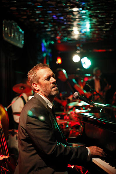 "Hugh Laurie performs in a blues band, and given the fact he was snubbed for the farewell season of ""House,"" he's got material for a new song. <style type=""text/css"">