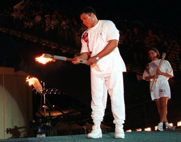 Boxing legend Muhammad Ali, visibly fighting the symptoms of Parkinson's disease, lights the Olympic flame in Atlanta to open the 1996 Summer Games. If you watched it, it's a moment you'll never forget.