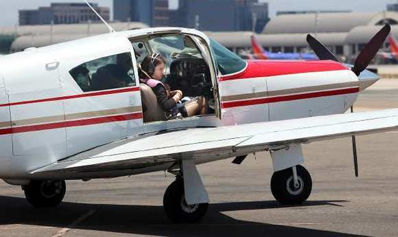 Eulalia Garcia-Amini anticipates her first time flying as she prepares to take off in a Piper Comanche airplane as part of a Boys & Girls Club of Laguna Beach event Tuesday at Lyon Air Museum.