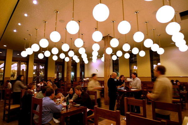 The dining room at The Publican, a must for first time Chicago visitors.