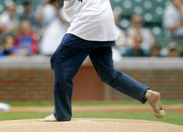 Tom Willis, who was born without arms, throws out a ceremonial first pitch with his foot before the Chicago Cubs take on the Miami Marlins at Wrigley Field.