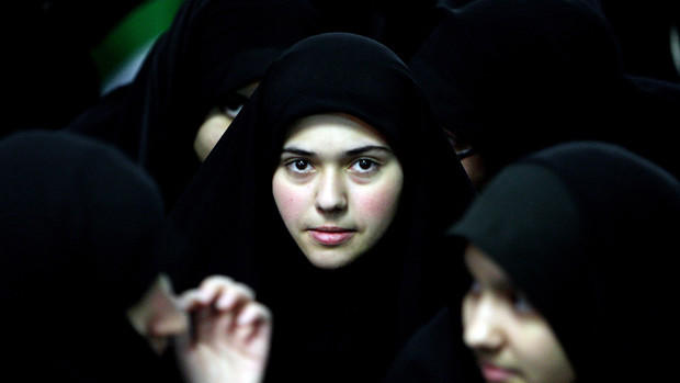 Iranian women attend a ceremony marking