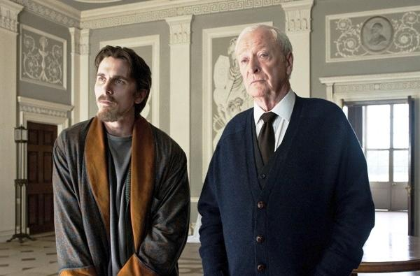 "Christian Bale and Michael Caine star in ""The Dark Knight Rises."""